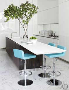 Reed & Delphine Krakoff:  Kitchen The kitchen cabinets, counters, and island are by Boffi, the barstools are by Derin, and the sink fittings are by Bulthaup.