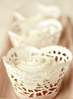 { Doily Cupcake Wrappers - The Brides Diary via Flights of Fancy Blog } --PERFECT for Kay's Birthday party!