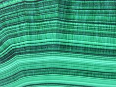 Malachite is a copper carbonite hydroxide mineral