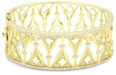 """Katie Decker """"Gothic"""" 18k Yellow Gold and Diamond Arch Cuff Bracelet Katie Decker. $14740.00. Made in Hong Kong. Stunning architectural detail and micro pave diamonds give this cuff an enchanting feel. 2.17 carats of micro pave diamonds. Hinge bracelet with push button closure and safety clasp"""