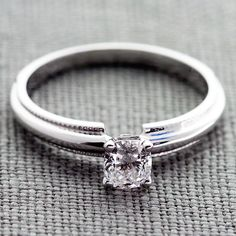 Our Milgrain Comfort Fit Engagement Rings with a 0.30 Carat F VVS2 Center Diamond