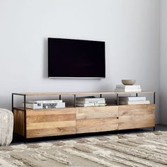 Crafted from solid mango wood and lofted on slender steel legs, our Industrial Storage Media Console brings an earthy charm to the bare-bones media console. In a grand 203cm width, it features four drawers and two open shelves — that means even more space to store books, cable boxes and other electronics.