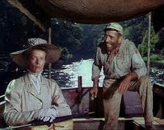 """""""...ya crazy, psalm-singin' skinny old maid.""""  Humphry Bogart and Cathrine Hepburn in The African Queen"""