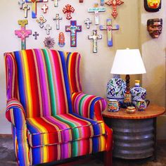 Love Mexican serapes, rebosos, panchos and blankets, so this chair is perfect! From Surroundings in Houston, one of my favorite stores.