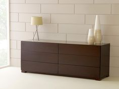 Available in Walnut, Oak & White The 6 drawer chest is a commanding piece of furniture that can be used in the bedroom or the living room as a side unit.