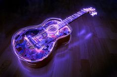 Light painting photography - you simply use a slow shutter and flashlight. It would definitely be cool to have an electric guitar with neon lighting now wouldn't it?