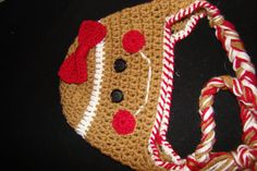 Gingerbread Girl Earflap Hat with braid ties and attached bow. $15.00, via Etsy.