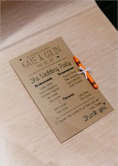 wedding program with a crayon