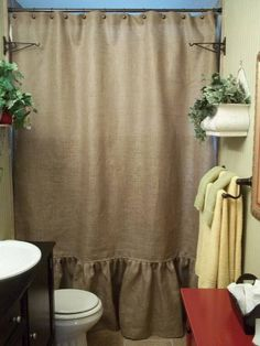 "Natural burlap shower curtain with ruffle bottom 18 inches ruffle 72"" inches wide Seam to get the width Basic holes for ring insert Color natural Serged edges  Great quality burlap 10oz  Thanks for looking :)"