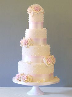 white wedding cake with pale pink accents ~ we ❤ this! moncheribridals.com