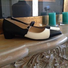 """Black & white modern Mary Janes Tildon Calla  blank and white color block Mary Jane pump adjustable strap with buckle closure. Pointed toe with a 1"""" heel. Slight ink mark on left shoe. Nordstrom Tildon Shoes Flats & Loafers"""