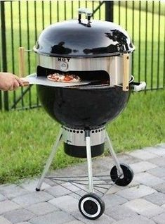 Pizza Oven Kit. Transform your Weber style Kettle Grill into a Deluxe Wood Burning Pizza Oven. This Kit is designed for 18.5 inch and 22.5 inch Charcoal or Wood Burning Kettle Grills and Smokers. The round sleeve is constructed of rugged 20 gauge, 304 grade stainless steel, so, it will last for years to come. Prep your pizza anyway you like it and slide it in the entry window.