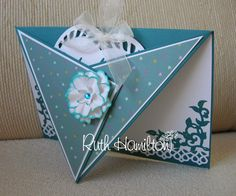 I simply scored and folded the front of the card over to the centre point and created a pocket for one of the Heart Base dies which I used as a tag.