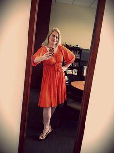 Thrifty find orange dress and floral heels.