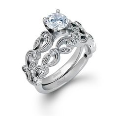 Serenade Collection - This gorgeous 18K white engagement ring and band is comprised of .28ctw round white Diamonds. - TR473