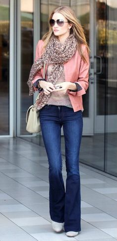 Rosie Huntington-Whiteley looking very stylish in salmon-coloured leather jacket and dark-wash denim jeans.
