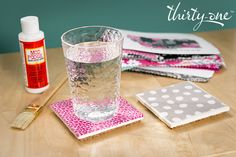 Tiles, cork, Mod Podge and old Thirty-One fabric swatches make fun, functional coasters! Coordinate your favorite prints to make a statement.