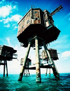 Abandoned Maunsell Sea Forts, England (Looking more than a little like rusted AT-ATs, the Maunsell sea forts were small fortified towers built by the UK in the Thames Mersey estuaries during World War II and decommissioned in the late 1950s.One became 'Sealand', the self-described 'micronation' with a controversial status as a data haven. The rest stand empty, just waiting to become the lairs of supervillains)