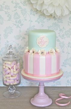 mint green with pink and white stripes cake