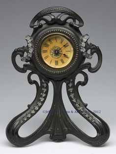 Art Nouveau Western Clock Co. ~ Dresser Clock, spring movement, patinated cast-iron frame. First quarter 20th century.