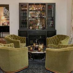 Hollywood Regency Green and Black Living Room with Industrial Metal Casement Bar Cabinet Bar Lounge, Hollywood Regency, Modern Bar Cabinet, Metal Industrial, Industrial Farmhouse, Home Bar Rooms, White Bar Stools, Bar Cart Decor, Bar Design