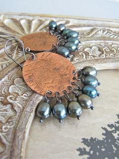 The Forest Walk earrings - textured copper, sterling and plump green freshwater pearls.