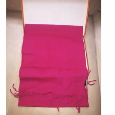 100% Cashmere fuchsia scarf Super gorgeous scarf in full box and wrapping. Brand new never worn. Received as a gift last year. Not sure of authenticity since I never had a Hermes Scarf before. All pictures are of the real item that I'm selling. I don't wear pink scarf. Let me know if you want more pic. 100% luxurious cashmere. It feels amazing. Box is a little beat up bc I stored it in my closet and I have little space left. NO TRADE. Only taking offers via offer button Hermes Bags Totes