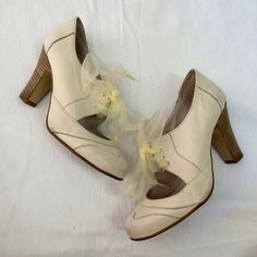 Cream booties Cream colored booties with ribbon lace up and 3 1/2 inch heel. A little discoloration on the front, but can be fixed  🚫 No trades // Only Poshmark transactions  💛 Shar 📱 Insta // Pinterest: sharguerieri Bakers Shoes Ankle Boots & Booties