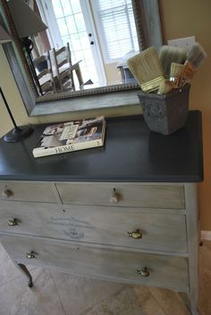 My first Annie Sloan adventure. Graphite high gloss top and Paris Grey with dark wax. I got some big beetle pulls for the larger drawers and made a transfer of French script with a bee and half wreath on one drawer. It was so much fun... now to my other collection in the garage!!!