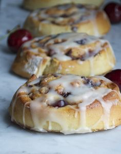 Cherry Almond Cinnamon Rolls - These rolls have been lightened up just a bit, but they are loaded with fresh cherries and little bits of sweet nutty almond paste. @NWcherrygrowers @OXO #10lbCherryChallenge