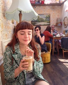 small girl in vintage cafe