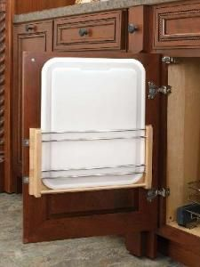 """15"""" Door Mount Cutting Board-Polyethylene. This wonderful door mounted rack plus cutting board-keeps your board tucked neatly away yet easily accessible at the same time. Door Mounted Cutting Board racks are made of wood that is protected with a UV-cured clear coat finish which allows an acceptable match to most cabinet finishes. Easy-4 screw installation."""