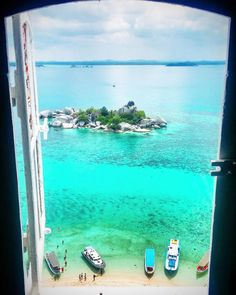 Stamp #356 - Indonesia: Imagine waking up with this view ! In Belitung Indonesia visit Lengkuas Island there you can go to the top of the lighthouse and look out on the Window of Paradise. Thanks @duengems for leaving your #stamp!  For more awesome travel tips and adventures download the Stamp Travel App Today. The link is in our bio!