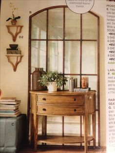 Large mirror behind small console table. Love