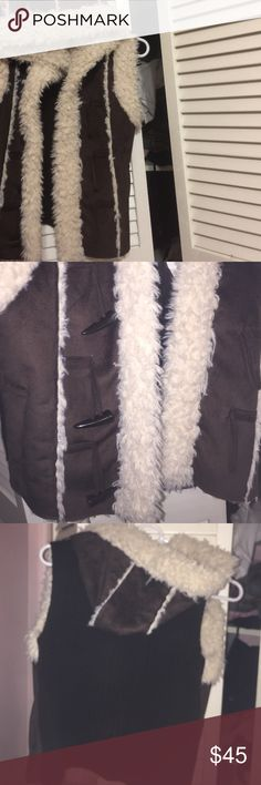 Very comfortable Katniss type of sweater Sleveless sherpa inspired warm coat it's a very cute piece for layering or wearing with a turtleneck or a long brown t shirt J.J. Basics  Jackets & Coats Utility Jackets