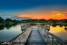 sunset over lake at the acreage in loxahatchee flo by CaptainKimo