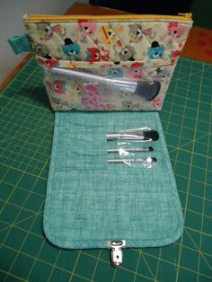 Cosmetics bag with built in brush roll.  Made with the free pattern from So Sew Easy
