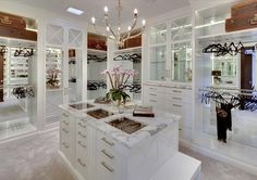 Looks like this closet needs clothes - I have plenty! Love the white with marble.