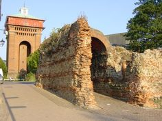 The 1st century Roman Balkerne Gate, Colchester, Essex, England. The area between the Balkerne Gate and St Mary's church, is also the place where people were martyred for their faith in the 16th century during the reign of Queen Mary. They were burnt at the stake for heresy. The Jumbo water tower seen behind was completed in 1883 to enable running water to be made available to the townspeople. .
