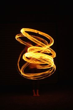 Model with fire poi. Slow shutter speed. Elements. Light. Liquid. Heat.