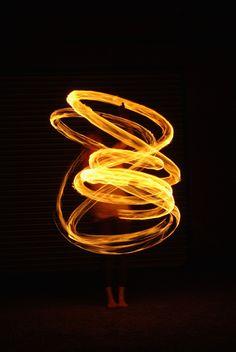 Model with fire poi. Slow shutter speed. Elements. Light. Liquid. Heat.