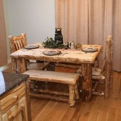 Aspen Log Dining Table shown in Light Aspen with matching side chairs and bench.- Rustic Dining