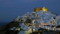 Stone castle of astypalaia Island towers over hora, Greece Seattle Skyline, New York Skyline, Beautiful Places, Beautiful Pictures, Greece Travel, Greek Islands, Nice View, Where To Go, San Francisco Skyline
