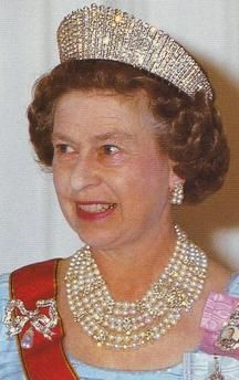 Jewellery of Today's British Royalty.  THE KENSINGTON BROOCH In July 1893 The Committee of the Kensington wedding gift fund representing the inhabitants of Kensington visited Princess May of Teck's home at White Lodge, Richmond, and presented her with this bow shaped diamond brooch with a large oriental pearl drop.  She wore the brooch at King Edward VII's coronation in 1902 and at her own coronation in 1911 as an appropriate symbol of her childhood at Kensington Palace. QE II now owns it.