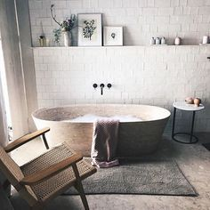 Master Bath Design Neutral and tranquil white master bathroom design with open shelving and stand alone tub with wall mount tub spout Rustic Bathroom Designs, Boho Bathroom, Bathroom Interior Design, Modern Bathroom, Small Bathroom, Bathroom Ideas, Bathroom Mirrors, Bathroom Faucets, Remodel Bathroom
