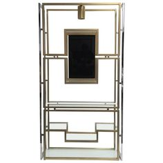 Elegant Étagère by Kim Moltzer, Finished in Brass, Chrome, Glass, 1968   From a unique collection of antique and modern vitrines at https://www.1stdibs.com/furniture/storage-case-pieces/vitrines/