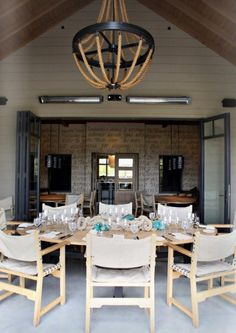 There's something about this -- think its the wheel. love that outdoor chandelier Nautical Dining Rooms, Nautical Interior, Outdoor Dining, Outdoor Spaces, Outdoor Decor, Outdoor Chandelier, Rustic Lighting, Beautiful Interiors, Living Spaces