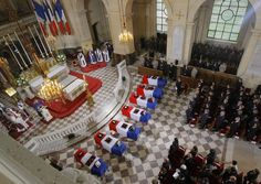 French President Nicolas Sarkozy, right, stands at flag-draped coffins inside the Church of the Invalides as tribute is paid during a national ceremony in Paris, to the seven French soldiers killed last week in Afghanistan. French President, Afghanistan, Coffin, Presidents, Soldiers, Flag, Paris, News, Photos