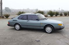 Saab 900 (no turbo) and white.  A real enigma of a car.  I'd drive one still.