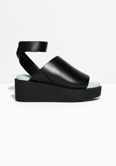 An asymmetric upper that curves gracefully on the foot is combined with a chunky rubber sole, featuring a facetted edge.